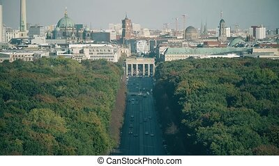 Telephoto lens shot involving most visited Berlin landmarks: Brandenburg Gate, Berliner dom and TV Tower