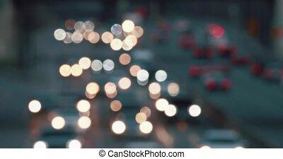 Telephoto shot of blurred highway traffic.