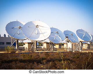 teleport satellite communications. Group of antennas in...