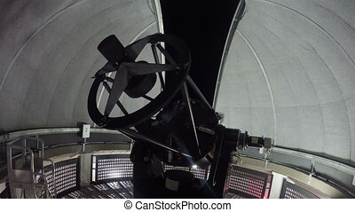 Telescope moving inside the dome of an observatory