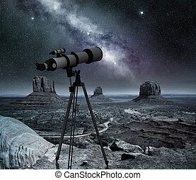 telescope pointed at the milky way in the monument valley