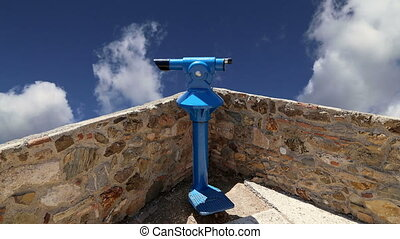 telescope viewer (tourist type telescope) against the sky...