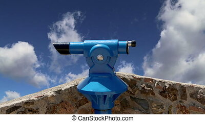 telescope viewer (tourist type telescope) against the sky...