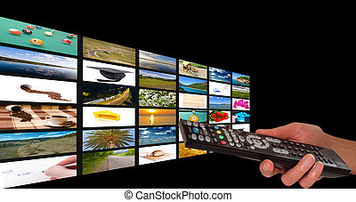 Television concept - Remote in womens hand chosing channel