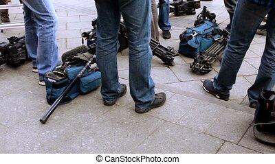 Television equipment lay on ground near operators legs