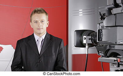 television news presenter and video camera - TV studio with...