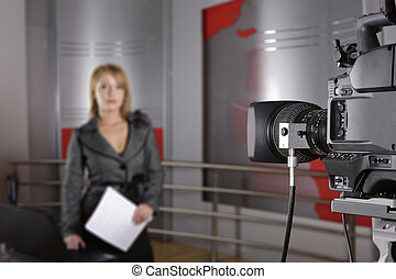 television news reporter and video camera