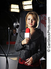 television news reporter and video camera - smiling...