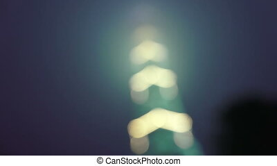 Television tower at night decorated with fires. St....