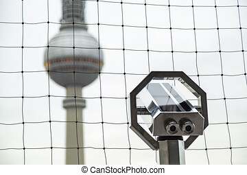 Television tower in Berlin and telescope near