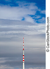 Television tower on the blue sky