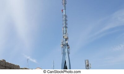 Television tower with antennas on the mountain above ...