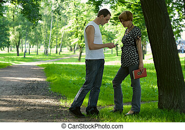 Man meets a woman in park and tries to make the acquaintance