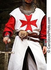 templar knight - man wearing templar medieval suit and...