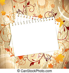 Template at wooden background over maple leaves