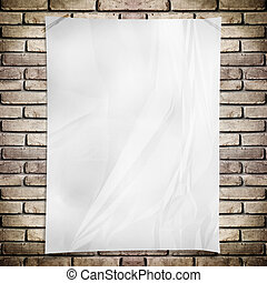 Template- White crumpled rectangle Poster on grunge brick wall