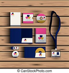 templates of hearts of corporate stationery over wooden background