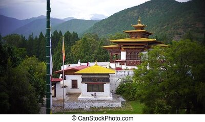 Temple and religious prayer flags in valley, Bhutan - Valley...
