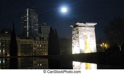 Temple Debot stands in moonlight beams against night sky