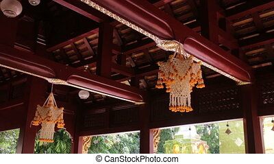 Temple decoration with bunch of flower in Thai traditional...