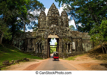 Temple entrance with wall - Ankor wat temple wall with tuk...