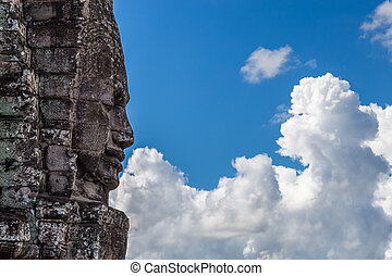 Temple face staring into the clouds