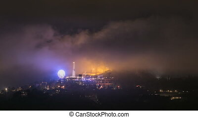 Temple of the Sacred Heart of Jesus timelapse on Tibidabo Mountain in Barcelona in clouds, Catalonia, Spain