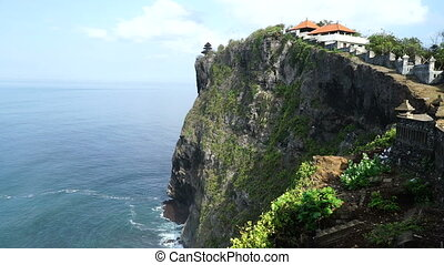 Temple on cliff over sea.