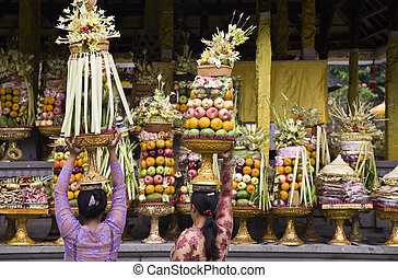 Preparing offerings for a temple ceremony in Bali
