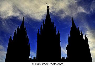 Mormon LDS Salt Lake City Temple Silhouette against Blue Cloudy Sky