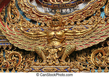 Temple statue - An ornamental golden figure on a Buddhist...