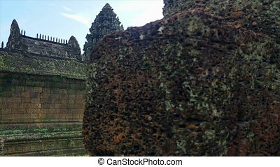 Temple walls and rocks - A medium shot of temple walls and...