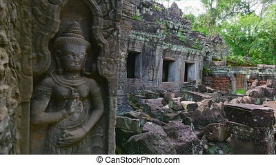 Temple with rock statue - A medium shot of a temple and rock...