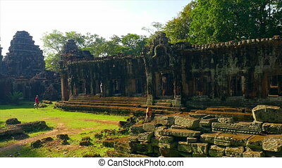 Temples and buildings with a calf - A wide shot of temple...