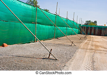 The temporary walls for protection and cover up the botched jobs during construction.