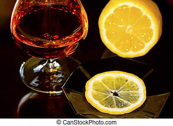 Temptation - Glass with Cognac. Some like it with lemon.