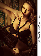 temptation - Seductive young woman in sexual lingerie posing...