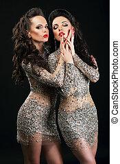 Temptation. Two Flirtatious Sexy Women Touching Each Other