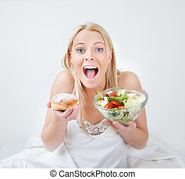 Tempted young woman making a food choice