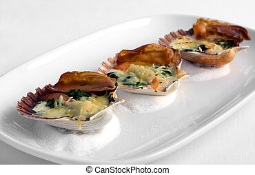 Tasmanian Scallops in the shell, grilled with Pancetta, Spinach, and a two-cheese sauce