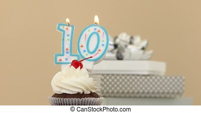 Ten 10 candle in cupcake pastel background - Number ten 10...