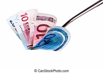 Ten and twenty euro banknotes on fork isolated over white background.