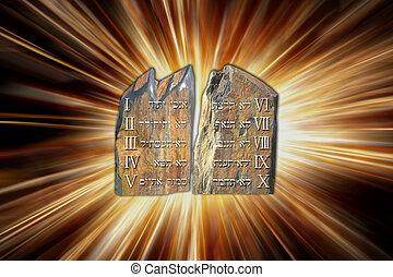 Ten Commandments on stone tablets by light