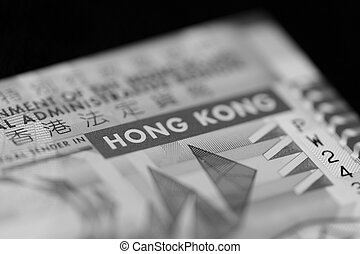 Ten Hong Kong dollars banknote on a dark background close up. Black and white
