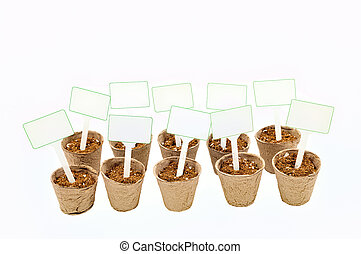 Ten Peat Pots With Soil and Signs Isolated On White