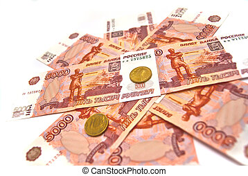 Ten rubles coins and five thousand banknotes