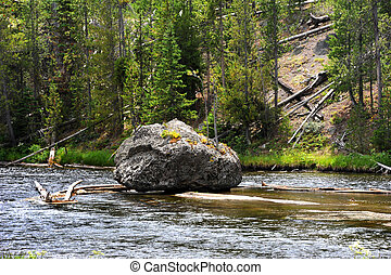 Tenacity in Yellowstone - Huge boulder sits all by itself in...