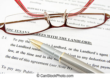 tenant agreement with the landlord - pen,glasses and tenant...