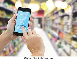 tenant main, supermarché, smartphone, moderne