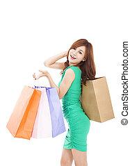 tenant sac, achats, femme, heureux, jeune